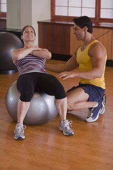What Muscles Are Getting Worked During a Swiss Ball Sit Up?Increase the challenge of your situps by performing them on a...