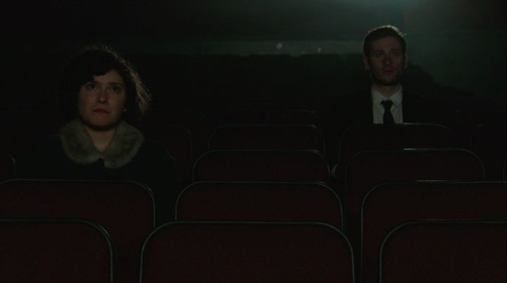 Man (Dave Coleman) and Woman (Katie Rose Summerfield) watch a classic film alone in ZEITGEIST ... Directed by Cenk Ertur...