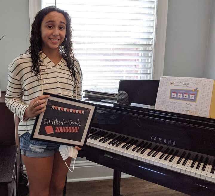 Today is the last day of summer lessons, and we ended it well!  Mia finished her first piano book today!! 🥳Mia plays the...