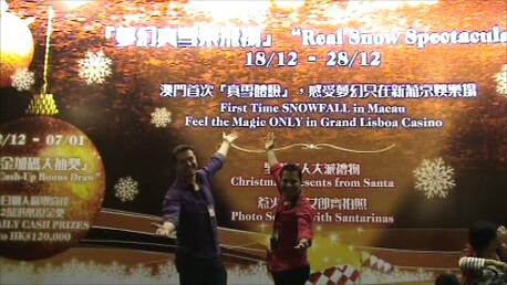 """Jeremy Vargus & Sam Soomro in front of RPI's """"Real Snow Show Spectacular"""" billboard showing at the Grand Lisboa Casino i..."""